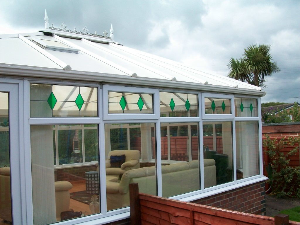 White upvc conservatory with decorative glass