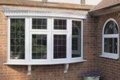 White upvc leaded bay window