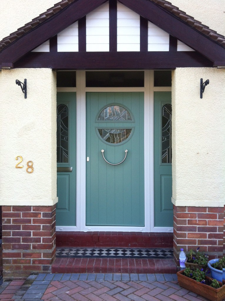 1930s style composite door in chartwell green
