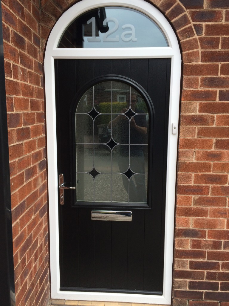 traditional style composite door with decorative glass