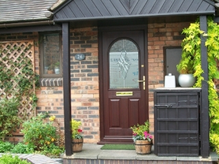rosewood upvc front door with decorative glass