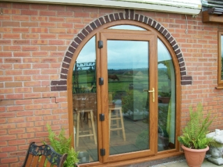 Light oak upvc french door with bespoke archway surround