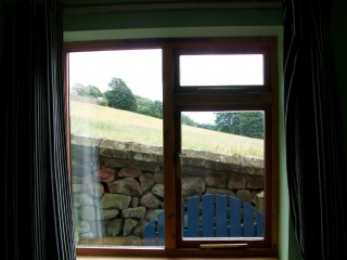 timber framed window with replacement double glazed units