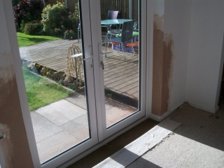 white upvc patio doors fitted by Window Repair Centre