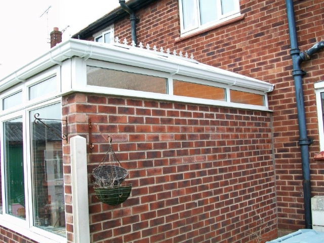 upvc conservatory roof repairs with new white guttering