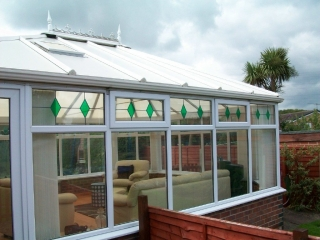 A large upvc conservatory with decorative glass