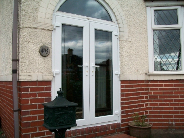 White UPVC windows fitted to a porch