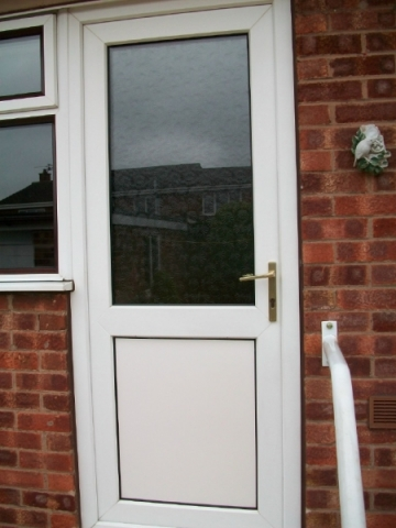 White upvc back door with privacy glass