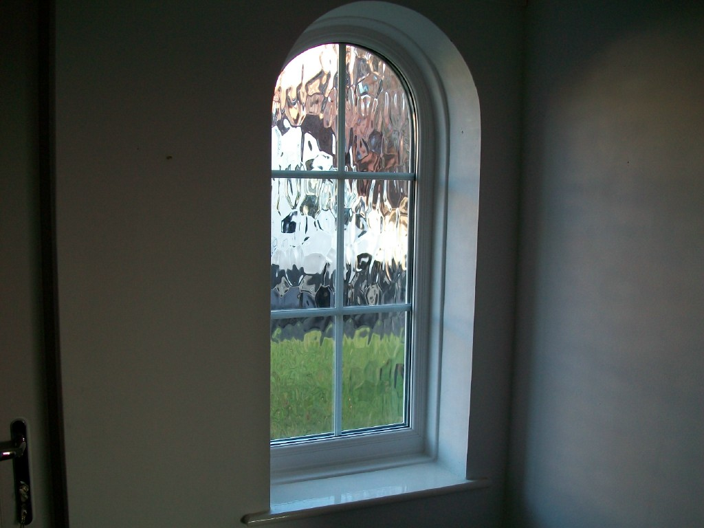 internal view of an arch shaped upvc window