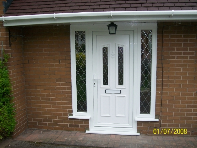 White upvc front door with leaded glass and glass surrounds