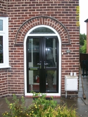 Black upvc french doors used in a porch infill