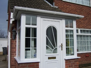 White upvc front door in a porch