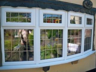 a large leaded upvc double glazed bay window