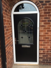 black composite door with etched overdoor glass