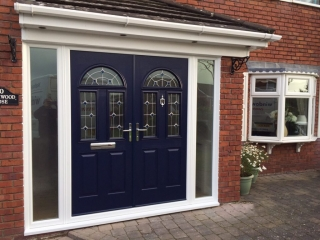 Double composite doors  in navy blue with matching decorative glass