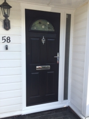 Composite door with comtemporary etched glass.