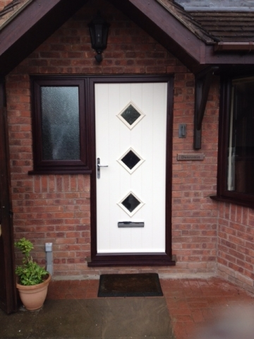 Contemporary composite door with 3 cottage style windows