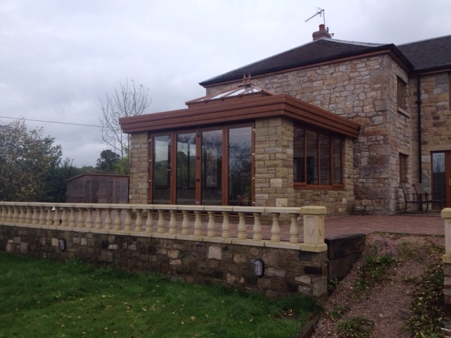 light oak upcv french windows and roof liught fitted to an orangery