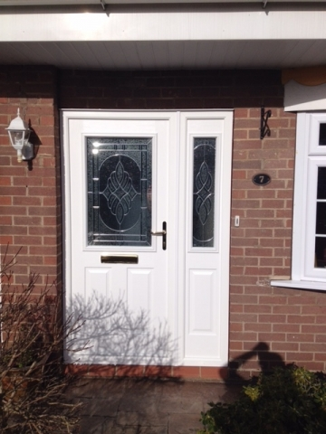 White composite door with decorative glass and side panel