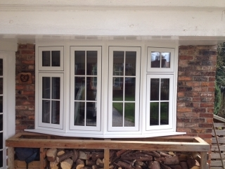 a new upvc bay window being fitted by the window repair centre