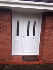 white upvc front foor with side panel and decorative glass