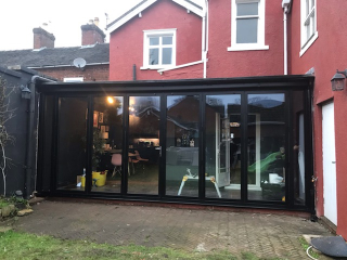 A lean to conservatory in UPVC black