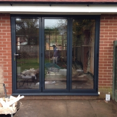Modern black bifold doors or french windows