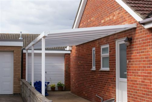 A white leanto carport with matching upvc guttering