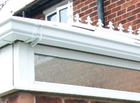 conservatory roof repairs showing white upvc guttering
