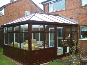 dark wood effect conservatory with matching guttering
