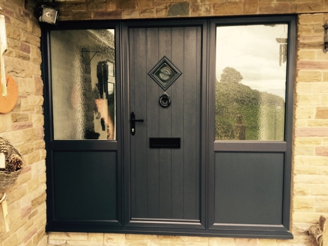 Contemporary slate grey composite door with side panels
