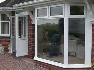 large white upvc bay window with white guttering