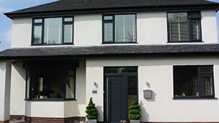contemporary slate grey windows and doors with matching fascias and guttering