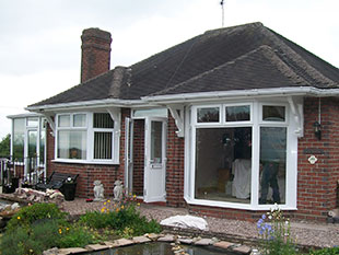 a bungalow with new white upvc guttering