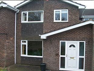white upvc fascias and guttering fitted to a 1970s property