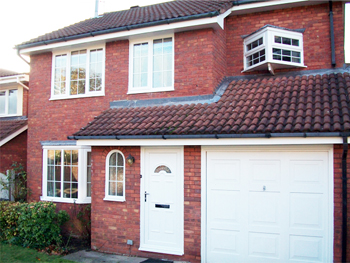 white upvc windows and fascias fitted to a 1990s property