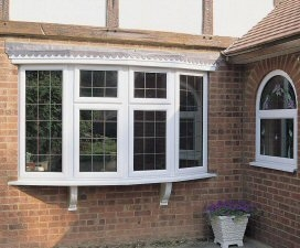 a upvc bay window and arched feature window