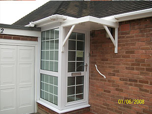 porch with overhang and white guttering