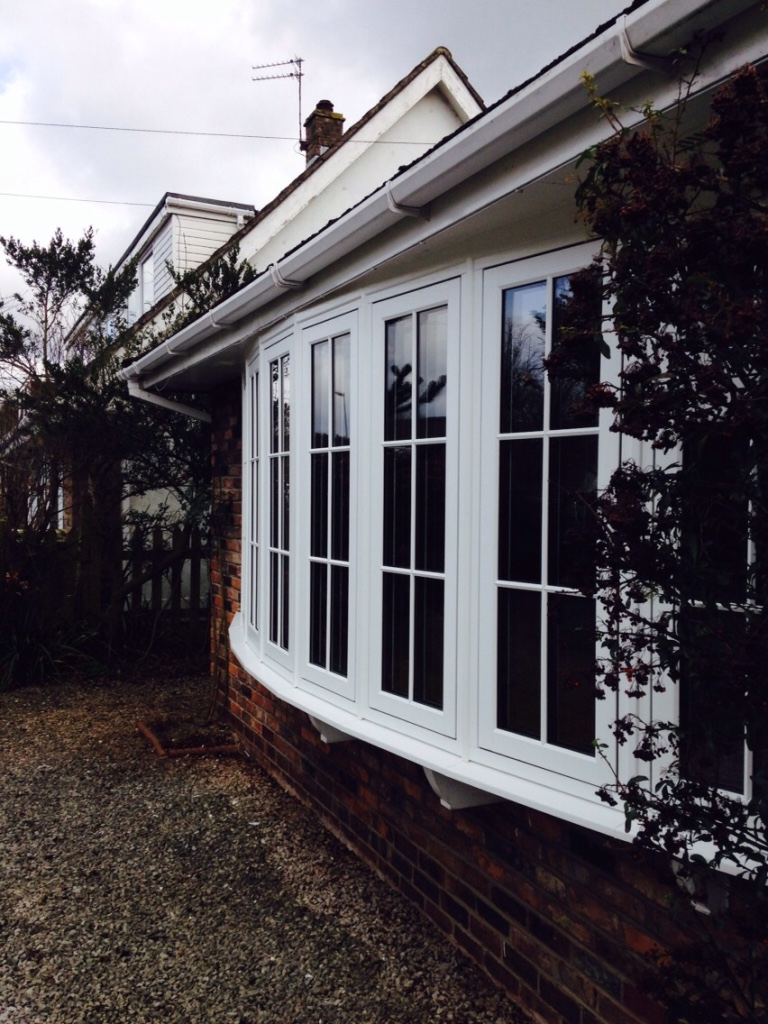 large white upvc bay window with cottage style frames