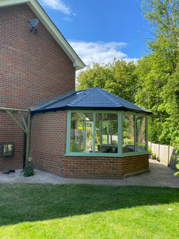 Side view of an octagonal conservatory with tiled roof