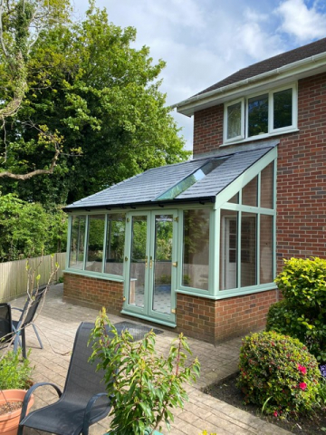 A modern orangery with lightweight tiled roof and contempory roof light