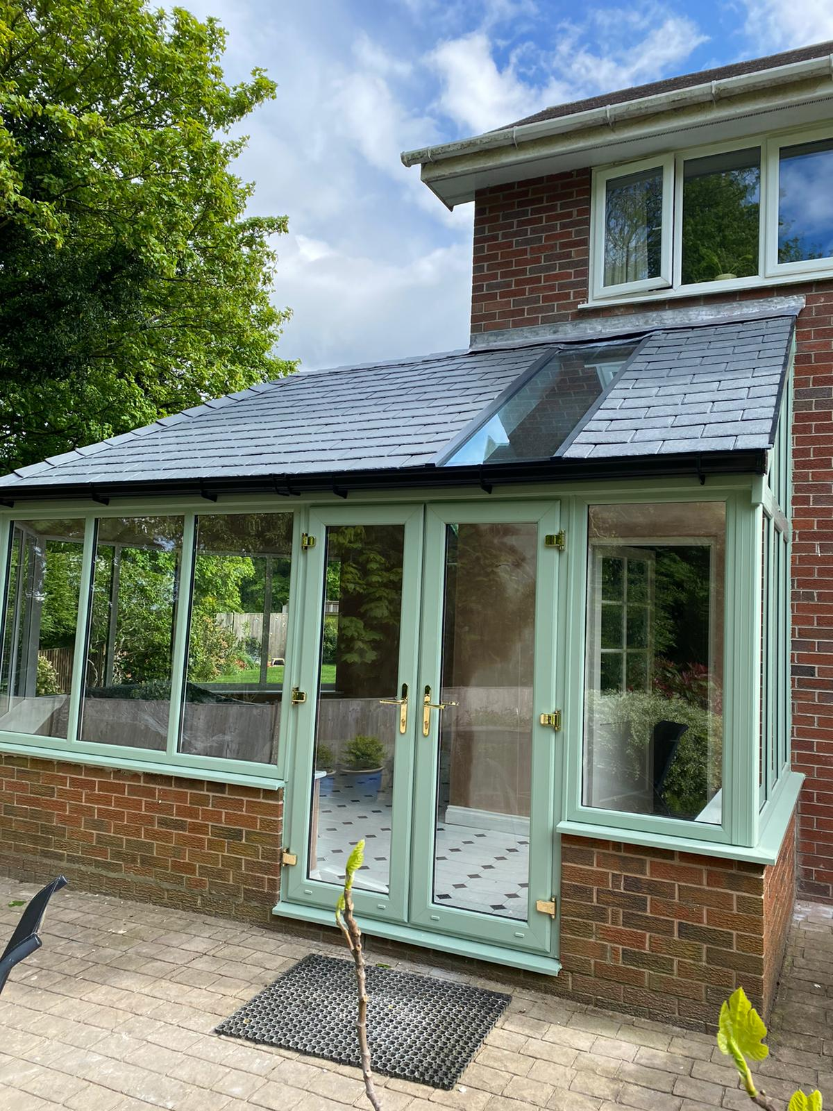 lightweight tiled conservatory roof with modern roof light